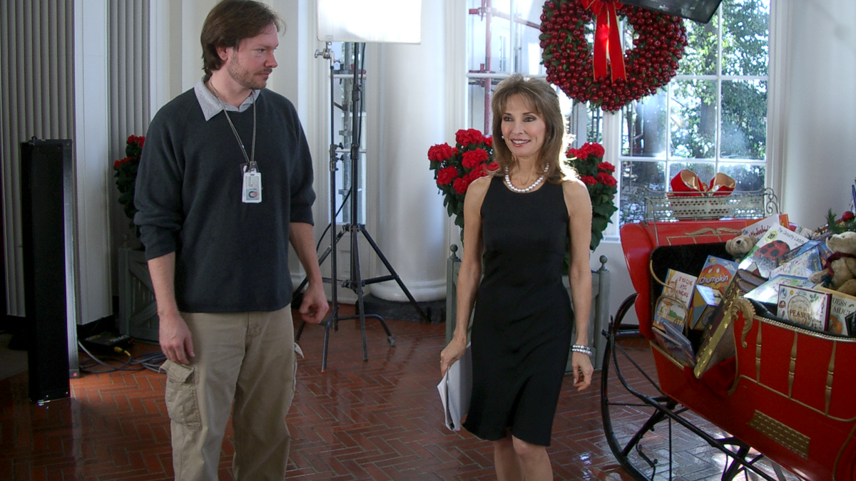 Cinematographer Dave Roberson working out the blocking with Actress Susan Lucci for An A&E White House Christmas Special