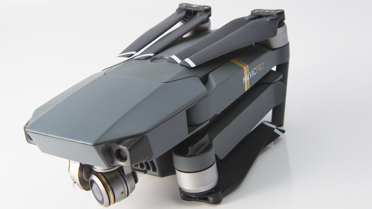 Folding rotor arms for easy transport