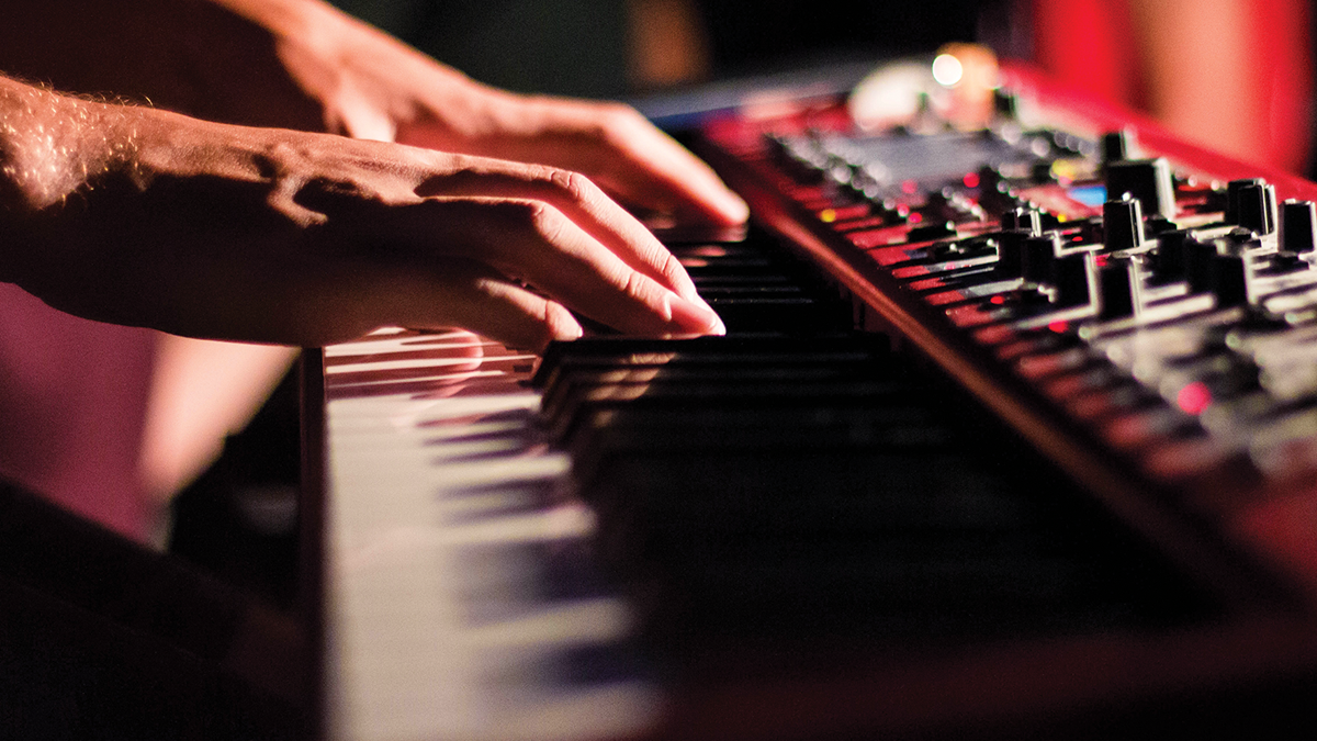 Close-up of hands on a keyboard