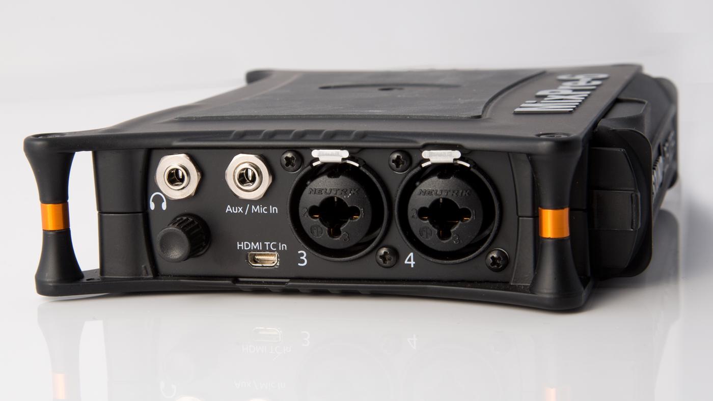 Headphone input with external knob for headphone volume.
