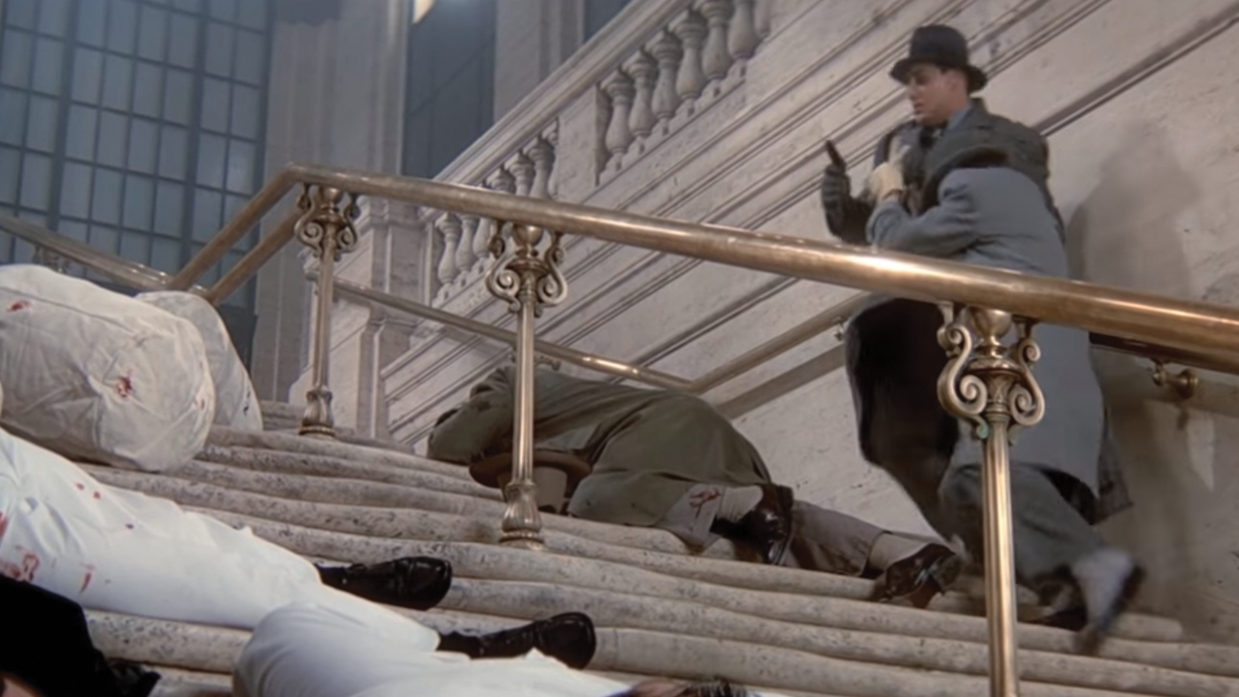 Capone's men take to the staircase and leave.