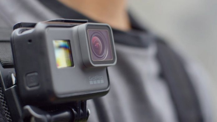 GoPro camera mounted on a shoulder strap