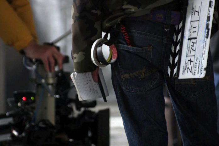 movie director carries production gear