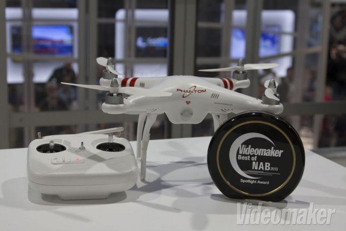 Phantom quadcopter next to a remote control and award