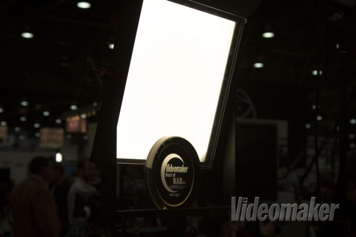 Diffused light panel shines behind a clear award
