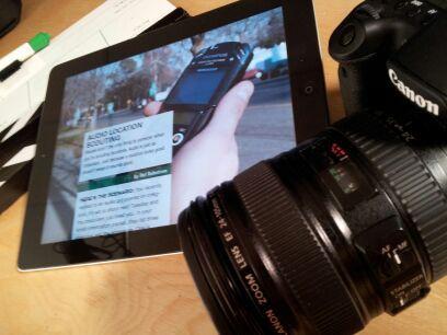 Photo of an iPad and DSLR camera