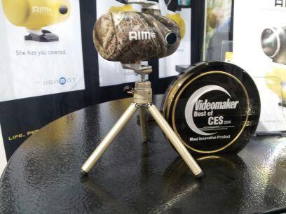 robotic module on a tripod and an award