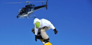 shot of a snow boarder jumping from a helicopter