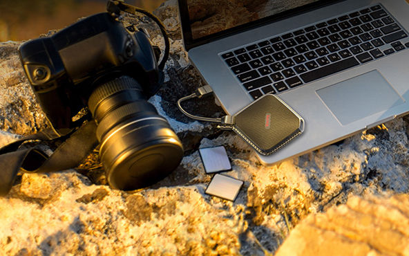SanDisk SSD with camera and laptop