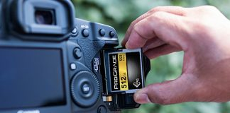 Hands putting a ProGrade Digital memory card into a camera
