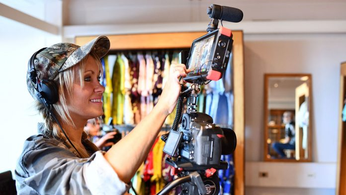 Woman using a D850 to film